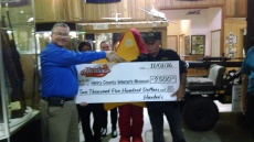 district-manager-glenn-postell-presenting-check-to-museum-director-jim-joyce